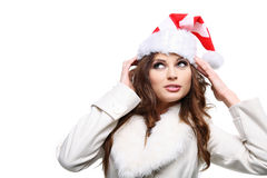 Beautiful woman posing as Santa Claus. Isolated. Royalty Free Stock Photography