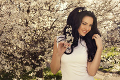 Beautiful Woman Posing At The Spring Blossom Park Stock Image