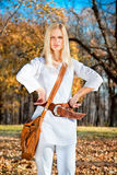 Beautiful woman posing in the autumn colored park Stock Photography