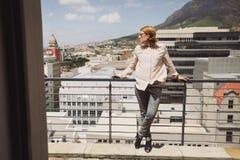 Beautiful woman posing on a balcony with coffee Stock Image