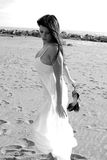 Beautiful woman posing on the beach with white dress black and white Royalty Free Stock Photos