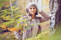 Beautiful woman posing in a birch wood Stock Image