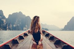 Beautiful woman posing on a boat royalty free stock photography