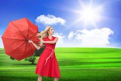 Beautiful woman posing with a broken umbrella Stock Photo