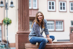 Beautiful woman posing at the camera in german city Royalty Free Stock Photos
