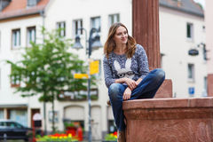 Beautiful woman posing at the camera in german city Stock Images