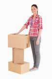 Beautiful woman posing with cardboard boxes Royalty Free Stock Images