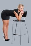 Beautiful Woman Posing with Chair Royalty Free Stock Images