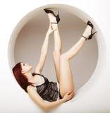 Beautiful  woman posing in circle Royalty Free Stock Images