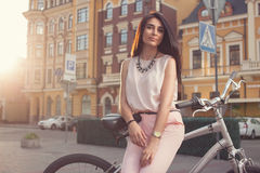 Beautiful woman posing with city bike Stock Images