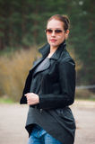 Leather Jacket. Closeup of beautiful woman on the walk Stock Images
