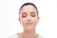 Beautiful woman posing with eyes closed stock photography