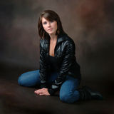 Beautiful Woman Posing in Jeans and Leather Jacket Royalty Free Stock Image