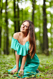 Beautiful woman posing in a forest Royalty Free Stock Photos