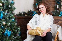 Beautiful woman posing with gift box royalty free stock images