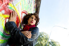 Beautiful woman posing with graffiti head Royalty Free Stock Photos
