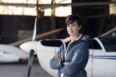 Beautiful woman posing in the hangar Stock Photos