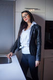 Beautiful woman posing in the kitchen. Royalty Free Stock Photos