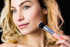 Beautiful woman posing with make-up brush Stock Image