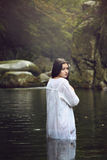 Beautiful woman posing in a mountain stream Stock Photography