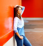 Beautiful woman posing near bright colorful wall Stock Photos