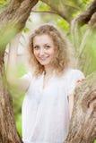 Beautiful woman posing near the tree Stock Image