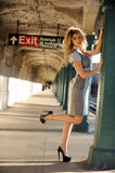 Beautiful woman posing in NYC subway station outside Royalty Free Stock Photos