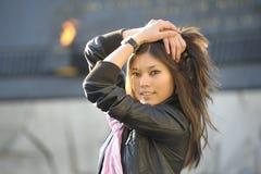 Beautiful woman posing outdoors. Beautiful asian woman posing outdoors royalty free stock photos