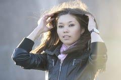 Beautiful woman posing outdoors. Beautiful asian woman posing outdoors Stock Image
