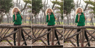 Beautiful woman posing in park during autumn season. Blonde girl wearing green blouse posing outdoor. Long fair hair girl Royalty Free Stock Image