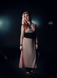 Beautiful woman posing in photo studio Royalty Free Stock Photo