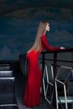 Beautiful woman posing in red long dress Stock Photos