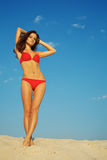 Beautiful woman posing on sand Stock Images