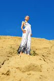 Beautiful woman posing at the sand place. Royalty Free Stock Images