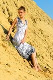 Beautiful woman posing at the sand place. Royalty Free Stock Photo