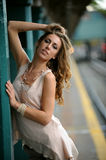 Beautiful woman posing sexy in NYC subway station outside Royalty Free Stock Images