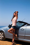 Beautiful woman posing in short on blue sea and sky background n. Ear cabriolet car in sun glasses stock photos