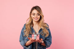 Beautiful woman posing with small giftbox royalty free stock image