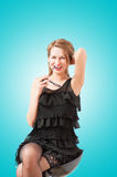 A beautiful woman posing and smiling coquettishly Royalty Free Stock Photos