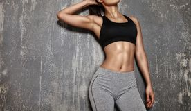 Beautiful Woman posing in Sport clothes. Sensual Fitness Model with Perfect Body Shapes. Healthy lifestyle, Diet. Beautiful woman posing in sport clothes royalty free stock photography