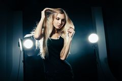 Beautiful woman posing at studio in light flashes Stock Image