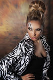 Beautiful woman posing in studio in zebra coat Royalty Free Stock Photo