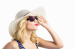 Beautiful woman posing with sunglasses against white background Stock Photos