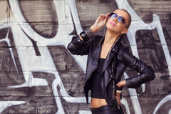 Beautiful woman posing in sunglasses Royalty Free Stock Image