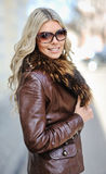 Beautiful woman posing wearing sunglasses Royalty Free Stock Images