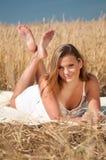 Beautiful woman posing in wheat field. Picnic. Stock Photo