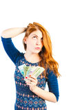 Beautiful woman posing on a white background with money Stock Images