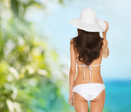 Beautiful woman posing in white bikini Royalty Free Stock Image