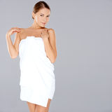 Beautiful woman posing in a white towel Royalty Free Stock Images
