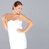 Beautiful woman posing in a white towel Royalty Free Stock Photo